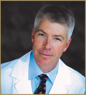 Dr. Hoffman in a white lab coat and black tie.