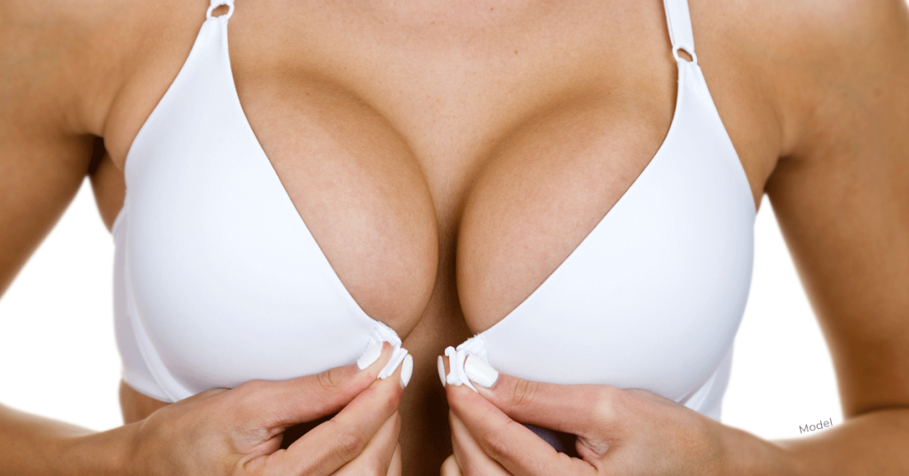 Woman in white bra with pronounced breasts